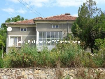 Cozy rural house is for sale located at the food of a mountain in the village of Mladinovo, Bulgaria.