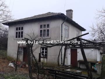 Affordable two-storey house is for sale with a beautiful view of the village of Bulgari, the highlands of Strandzha Planina, 18 km from the town of Tsarevo and the sea.